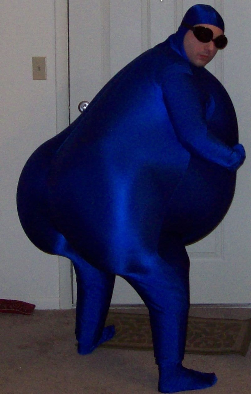 very fat man in shiny blue body suit wearing goggles