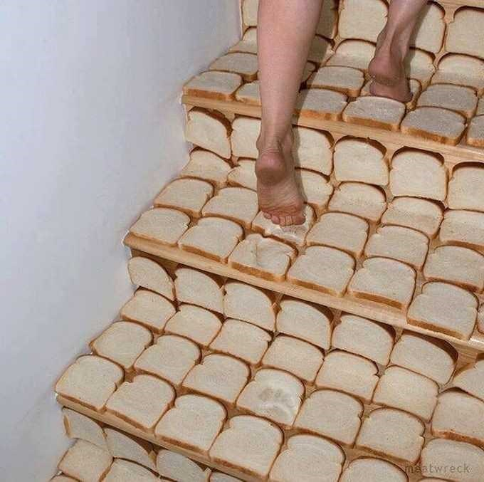 legs walking up stairs that are covered in slices of bread