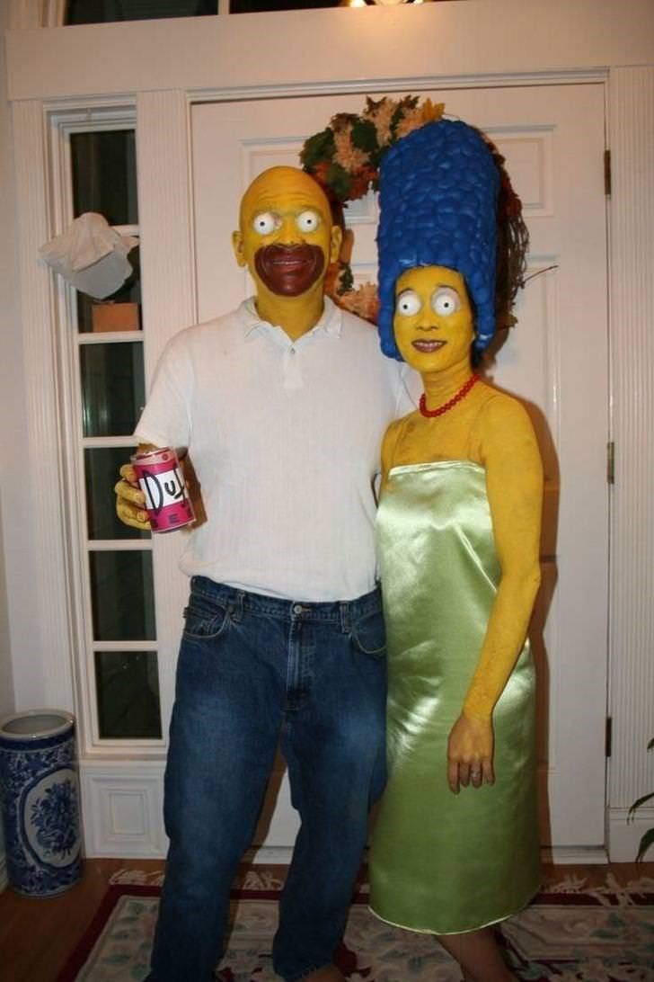 man and woman dressed up as homer and marge simpson looking creepy
