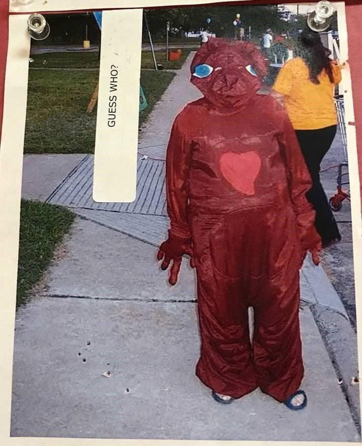 person standing in weird creepy red suit