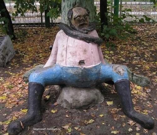 weird statue of man with legs spread open