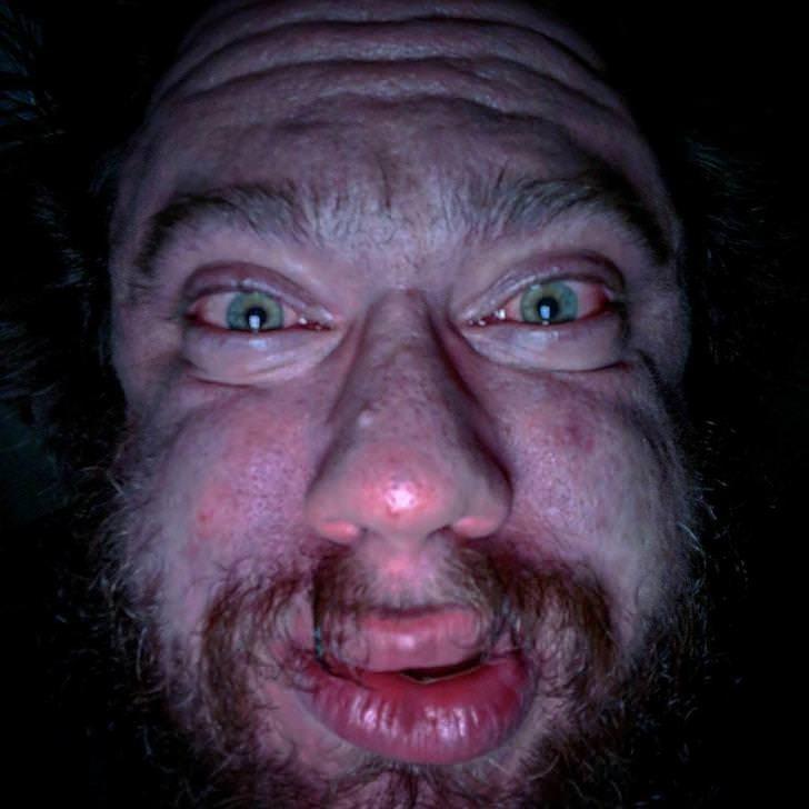 close up of a man's weird face