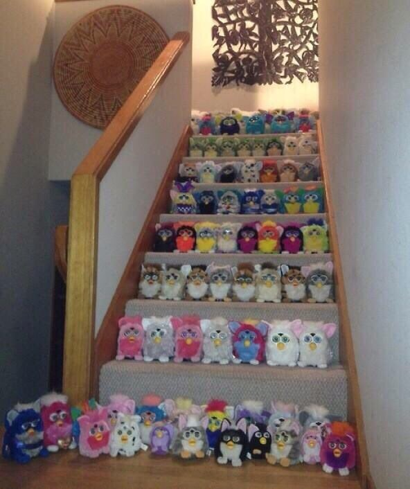 a full staircase covered with different colored furbies