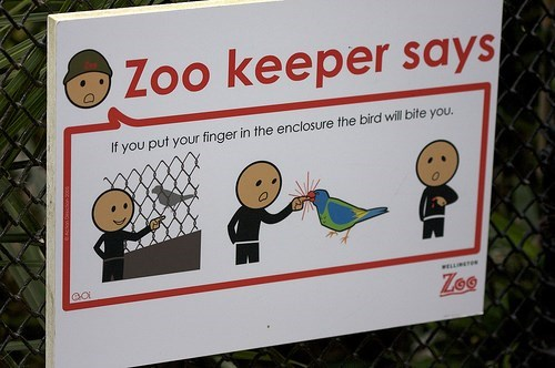 Signage - Zoo keeper says If you put your finger in the enclosure the bird will bite you. GO ELLE ZoO