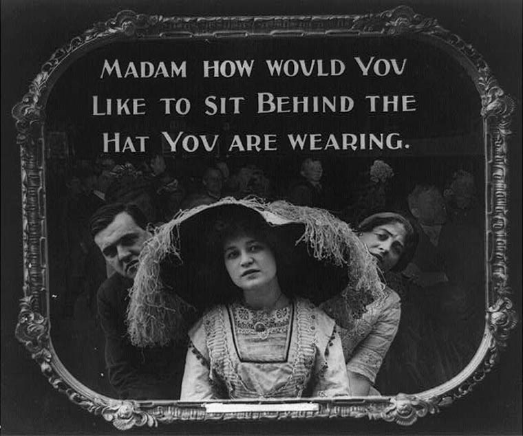 Text - MADAM HOW WOVLD YOv LIKE TO SIT BEHIND THE HAT YOV ARE WEARING. 40