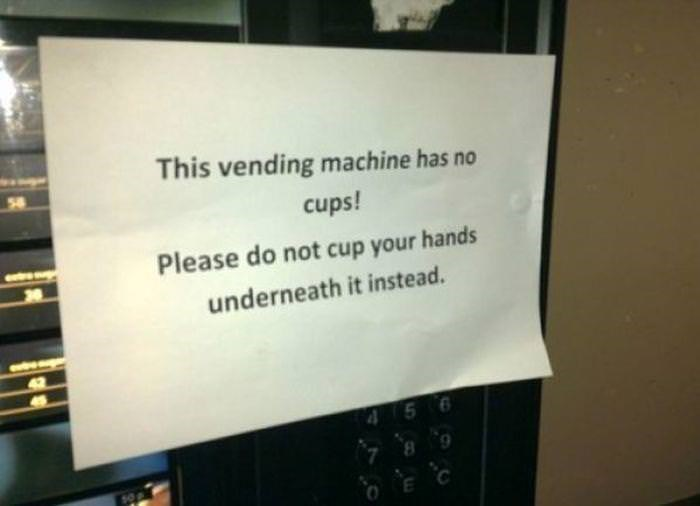 Text - This vending machine has no cups! Please do not cup your hands underneath it instead. 9 4 5
