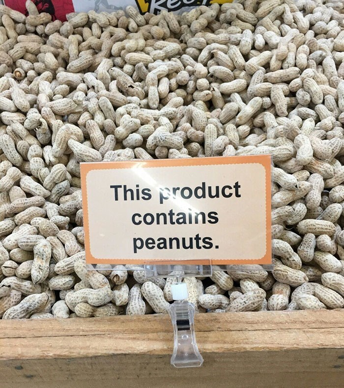 Text - This product contains peanuts.