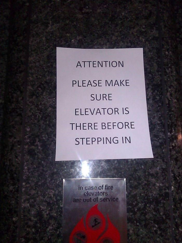 Text - ATTENTION PLEASE MAKE SURE ELEVATOR IS THERE BEFORE STEPPING IN in case of fire elevators are out of service