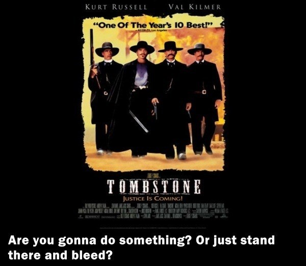 "Poster - VAL KILMER KURT RUSSELL ""One Of The Year's 10 Best!"" COADY,L TOMBSTONE JusTICE Is COMING! Are you gonna do something? Or just stand there and bleed?"