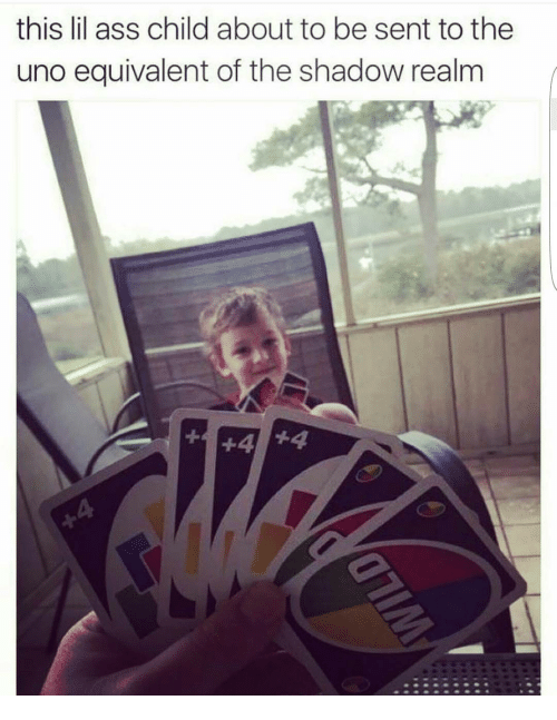 Child playing Uno with an adult