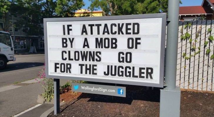 Street sign - IF ATTACKED BY A MOB OF CLOWNS GO FOR THE JUGGLER WallingfordSign.com f