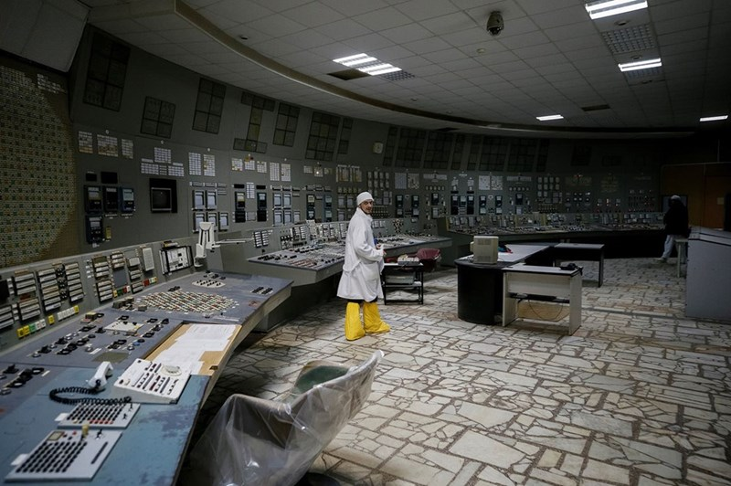 An employee walks in the control center of the stopped third reactor of the Chernobyl nuclear power plant in Chernobyl, Ukraine