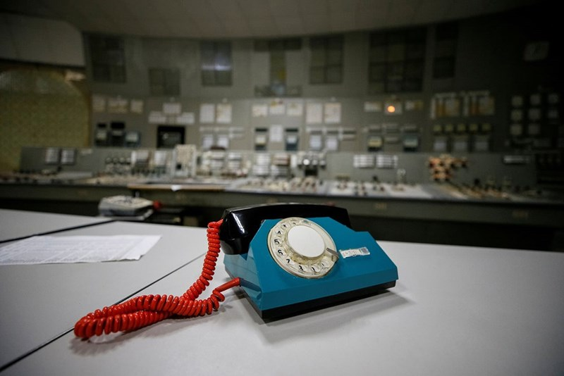 Chernobyl meme almost of control room with a stark old telephone in the control room t