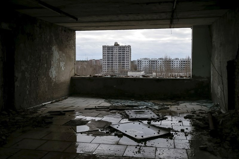 Abandoned room with view of the abandoned city of Pripyat after the Chernobyl disaster