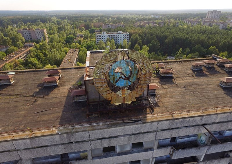 Pripyat apartment building with Soviet era hammer and sickle after the Chernobyl accident