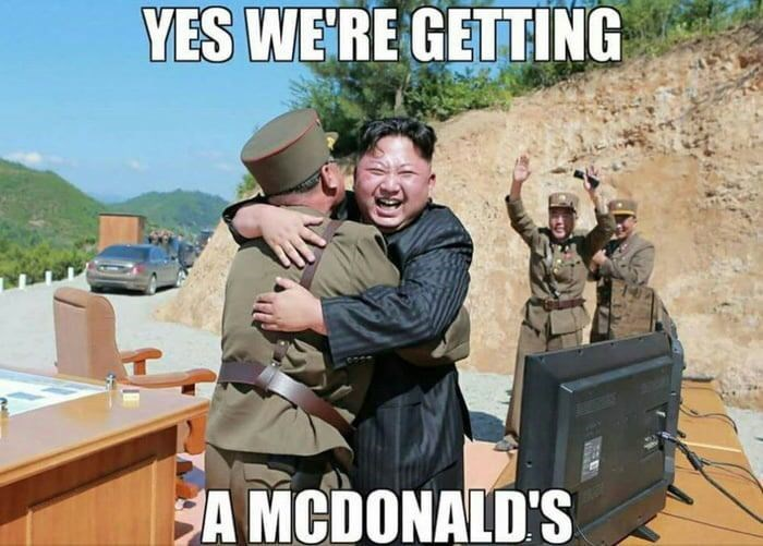 Photo of Kim Jong-Un hugging an officer saying that they will be getting a McDonald's