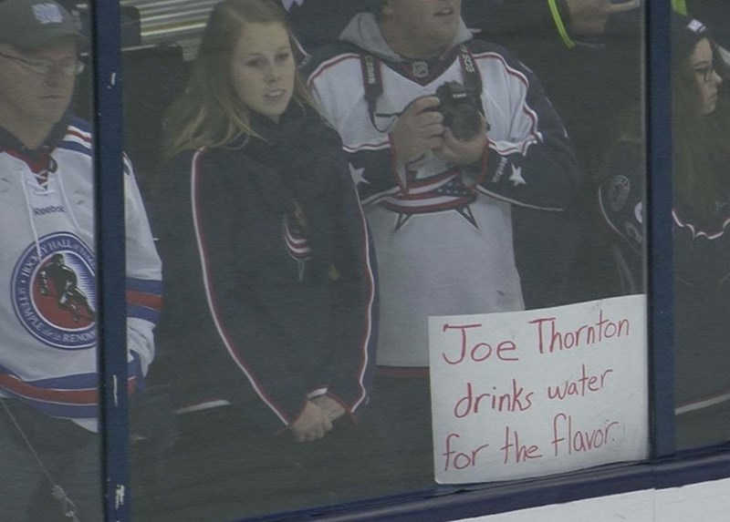 "Sign at a hockey game that says ""Joe Thornton drinks water for the flavor"""