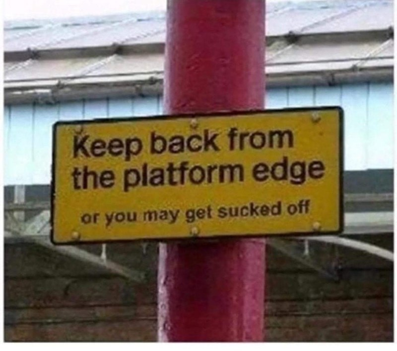 Street sign - Keep back from the platform edge or you may get sucked off