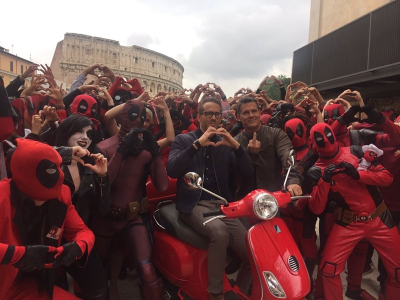 Original image of Ryan Reynolds making a heart sign with his hands and Josh Brolin flipping off the camera