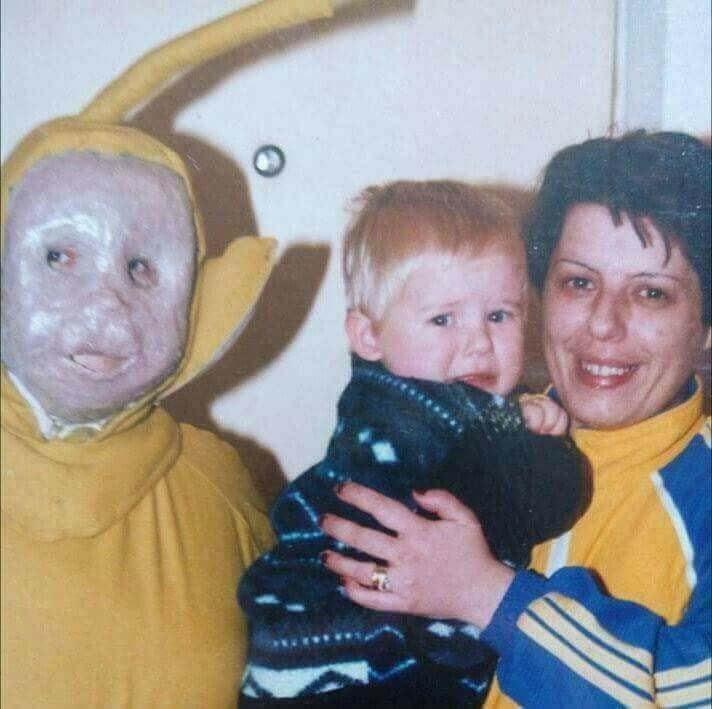 cursed images - photo of a kid crying near a person wearing a costume
