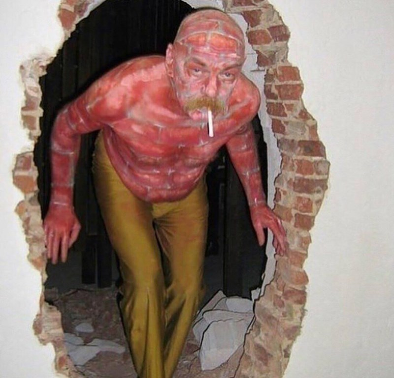 cursed images - Art man look like bricks and hole in a wall