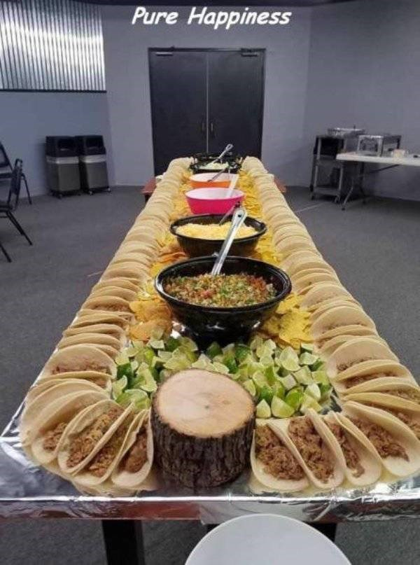 work meme of a long table filled with tacos