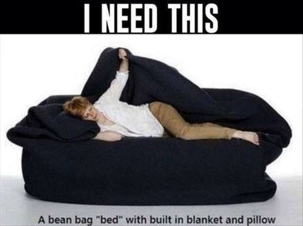 Photo of someone laying on a bean bag bed with a built-in blanket and pillow