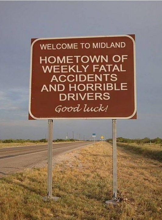 "Sign that says ""Welcome to Midland: hometown of weekly fatal accidents and horrible driver - Good luck!"""