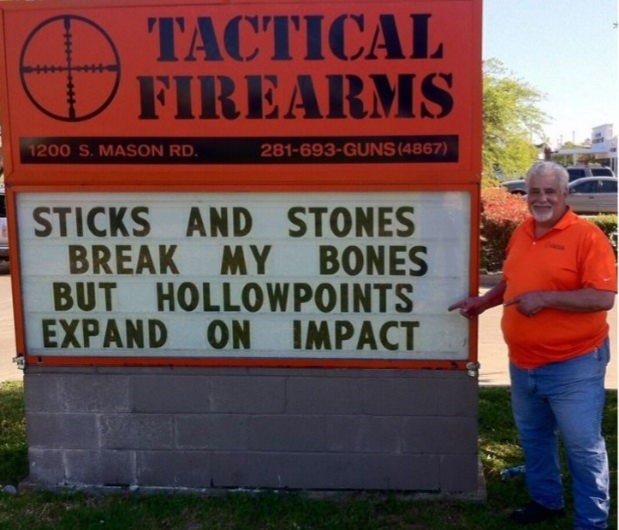 Sign - ТАСТICAL FIREARMS 1200 S.MASON RD. 281-693-GUNS (4867) STICKS AND STONES BREAK MY BONES BUT HOLLOWPOINTS EXPAND ON IMPACT