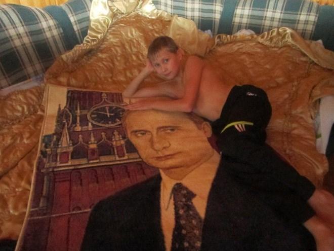 boy laying on putin themed sheets