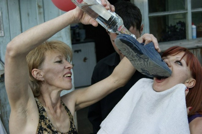 Woman drinking vodka out of a shoe