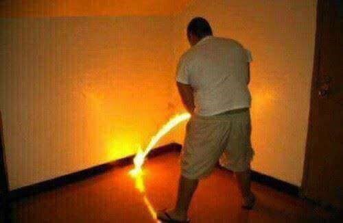 cursed image - man peeing fire