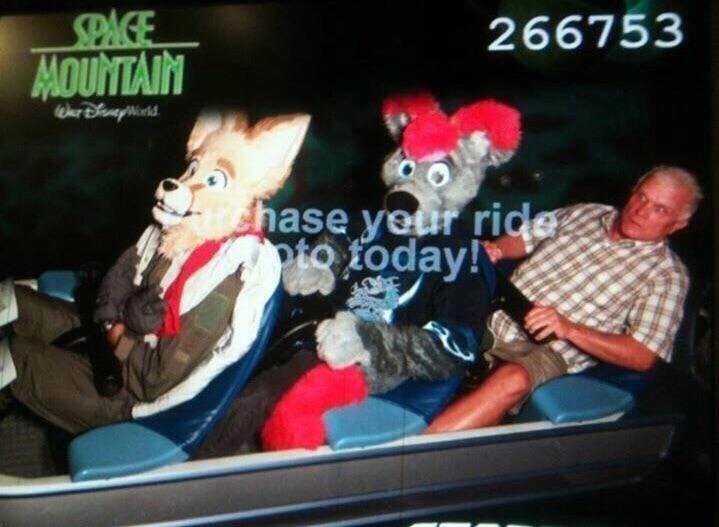 cursed image- creepy costume on a rollercoaster