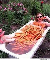 memes - bathtub filled with carrots and a woman sitting inside it