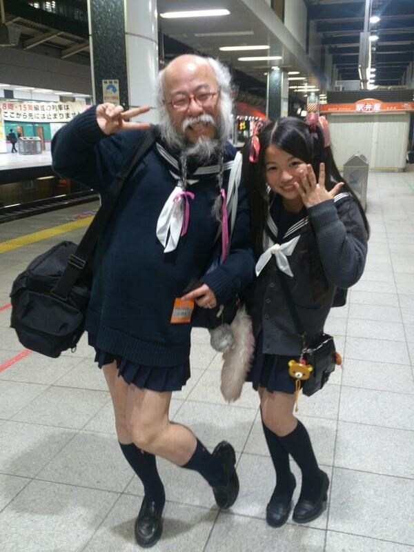 Japanese meme with picture of old man posing with young girl both dressed in school girls' uniforms