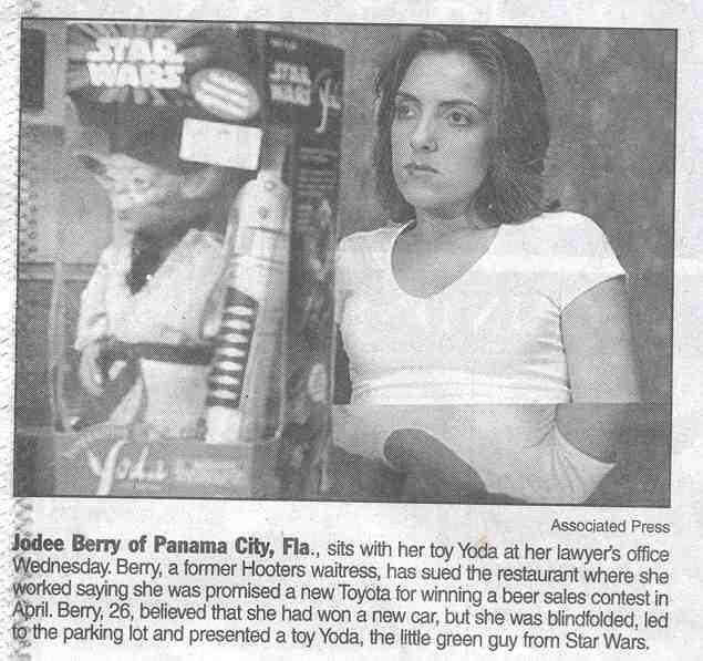Photograph - STAR WARS STAL WAR Associated Press Jodee Berry of Panama City, Fla., sits with her toy Yoda at her lawyer's office Wednesday. Berry, a former Hooters waitress, has sued the restaurant where she Worked saying she was promised a new Toyota for winning a beer sales contest in April. Berry, 26, believed that she had won a new car, but she was blindfolded, led to the parking lot and presented a toy Yoda, the little green guy from Star Wars.
