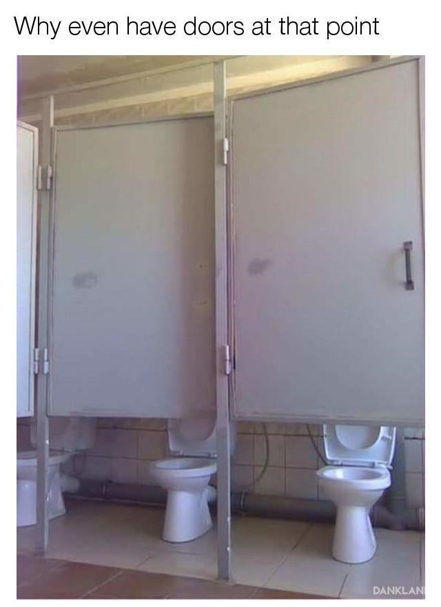 Bathroom stalls with doors above the toilets