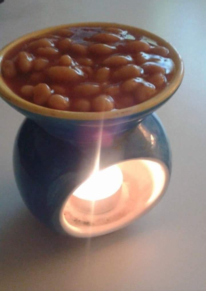 cursed_image - beans over a candle