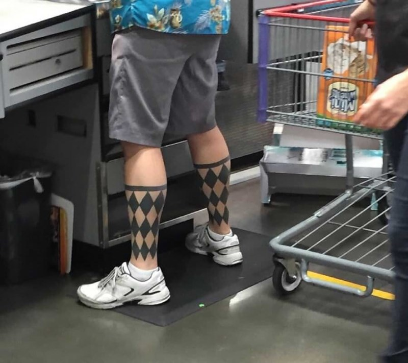 Man with argyle socks tattooed on his legs