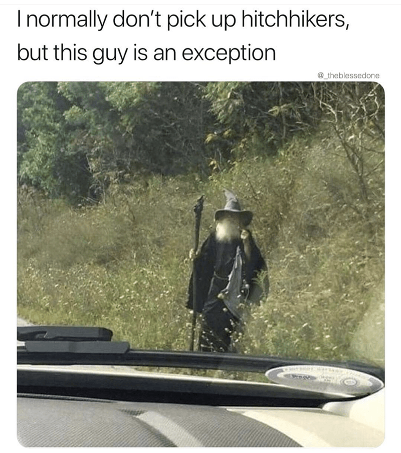Hitchhiker dressed up like a wizard on the side of the road