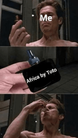 man looking at a bottle labelled africa by toto and drinking it