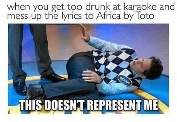 man lying on ground in checked vest next to other man's legs africa toto meme
