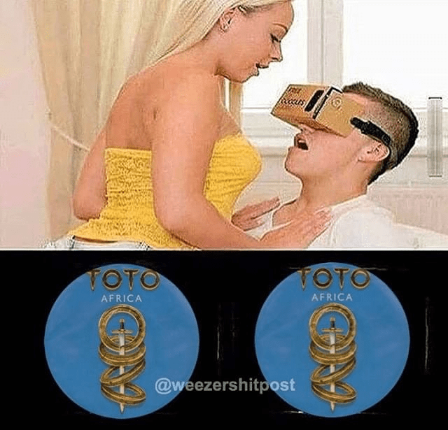man looking into virtual reality glasses with sexy girl above him and he sees africa by toto