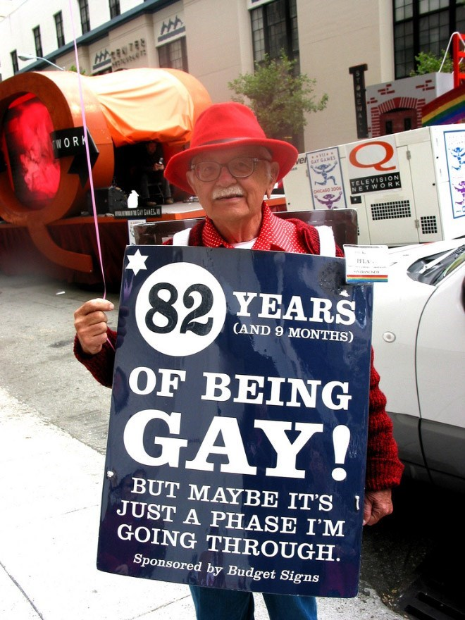 Protest - WORK Q er v GAY GANES TELEVISION NETWORK CHICASO 200 F CAMES PELA 82 YEARS (AND 9 MONTHS) OF BEING GAY! BUT MAYBE IT'S JUST A PHASE I'M GOING THROUGH Sponsored by Budget Signs