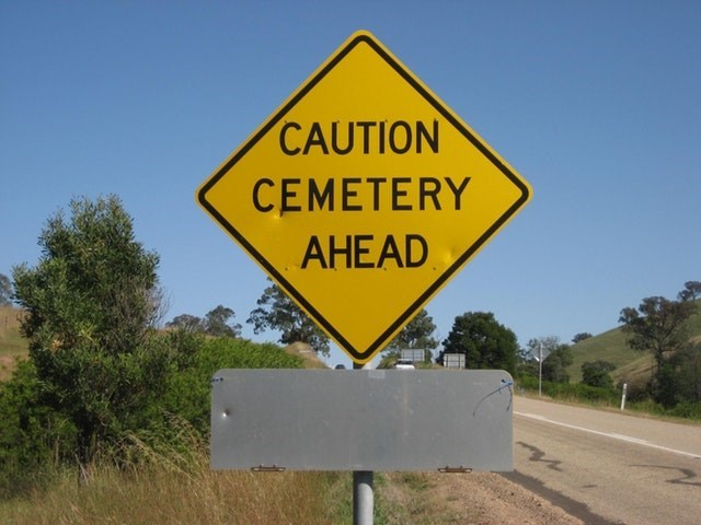 Sign - CAUTION CEMETERY AHEAD