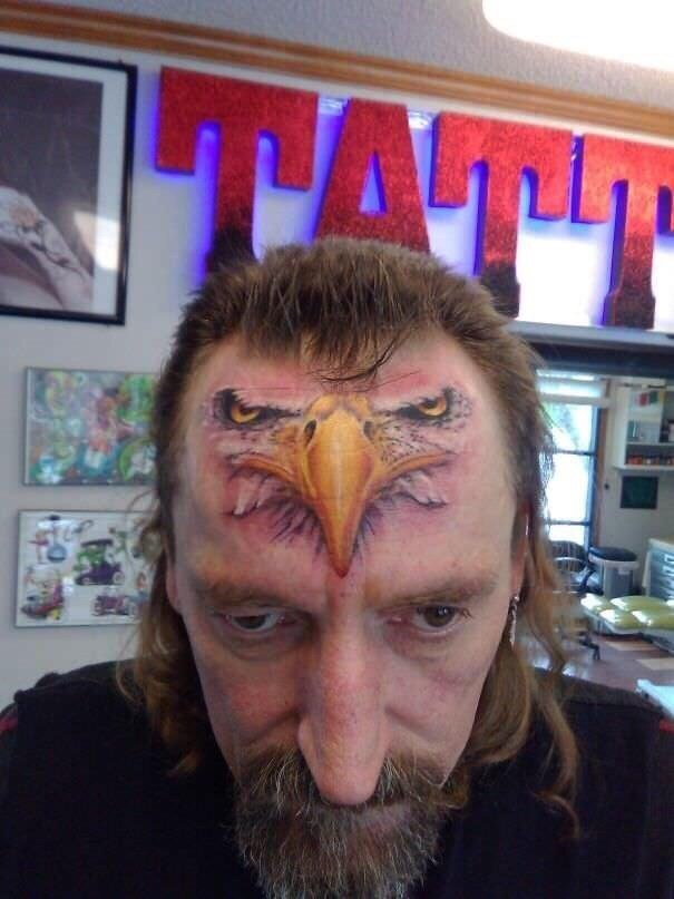 cursed_image - man with eagle tattoo on his forehead