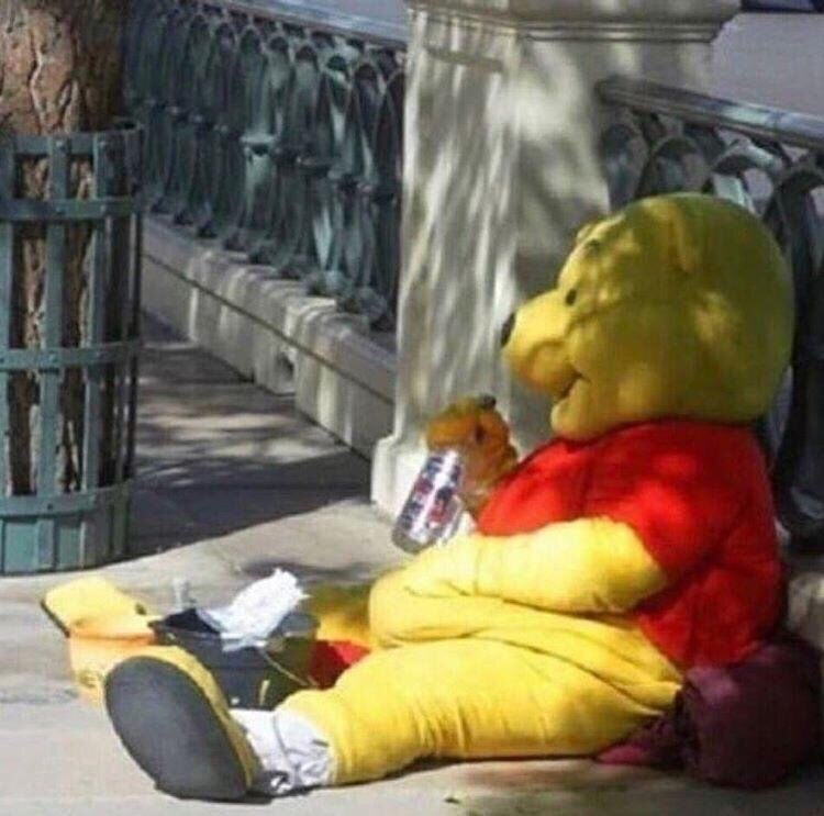 cursed_image - winnie the pooh costume drinking in the middle of the street