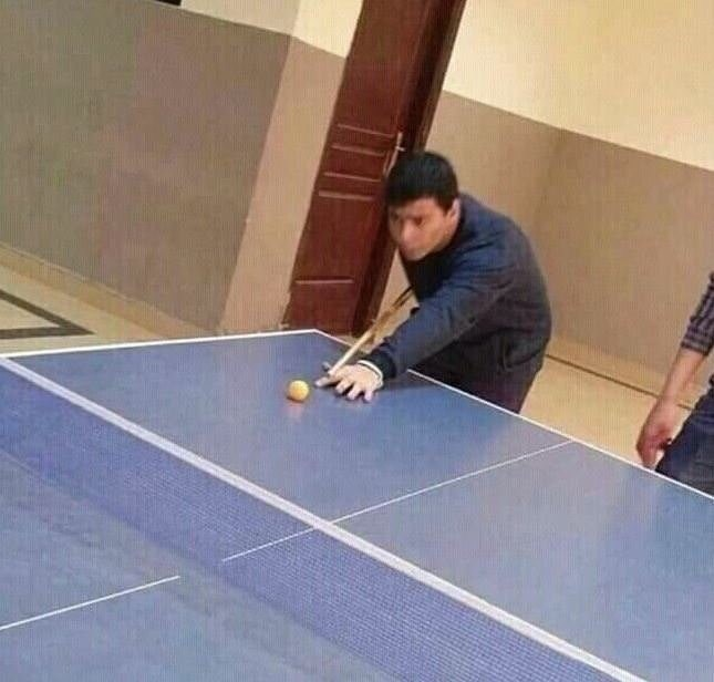cursed_image - playing pool on ping pong table