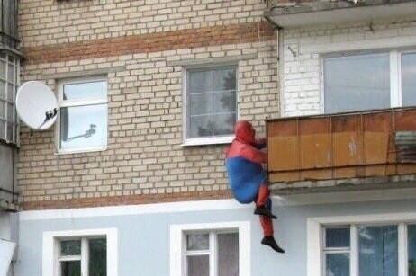 cursed_image - spideman climbing building