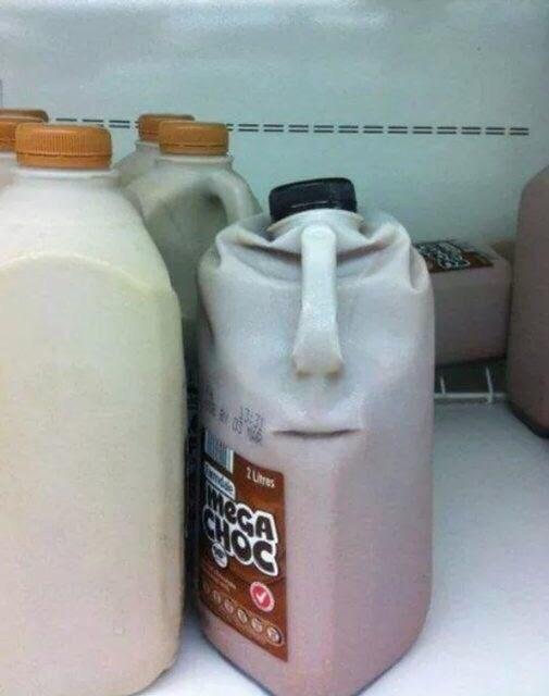 cursed_image - milk carton squashed looks like a face